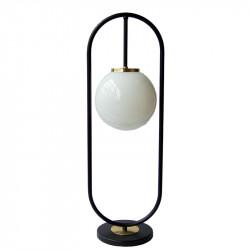 Lámpara de sobremesa, armazón metálico en acabado negro, con elementos decorativos de latón en acabado satinado